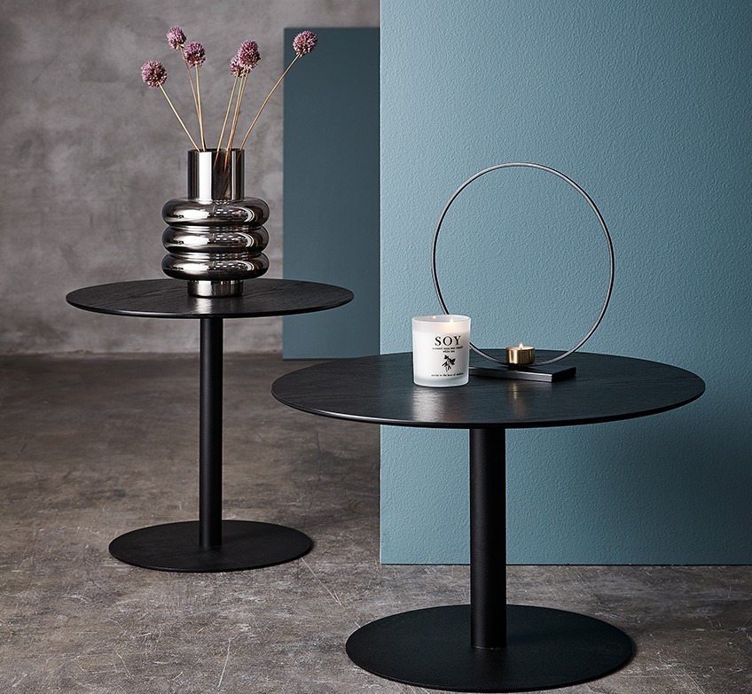 Two end tables in black with vase, scented candle and tealight holder