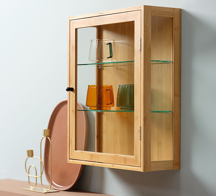 Small display cabinet with cups in different colours inside